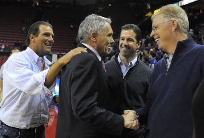 Ravens owner Steve Bisciotti (left) congratulates Gary Williams along with Ravens coach John Harbaugh and coordinator Cam Cameron after Maryland beat N.C. State in 2010.