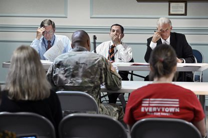 Maryland Handgun Permit Review Board members (l-r) Daniel Crowley, Chairman Frederic Smalkin and Jim Ballard hear a case during a recent meeting at the Fifth Regiment Armory.