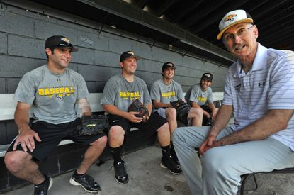 Towson baseball coach Mike Gottlieb (right) talks with players (from left) Mike Ryan, Garrett Walther, Joe Patton and Kyle Paul after practice on Wednesday.