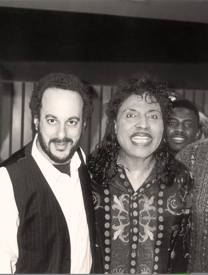 """Allan Charles, the creative director for Baltimore-based Trahan, Burden & Charles Inc., and rock 'n' roll legend Little Richard pose during a recording session for """"Go Play in the Yard,"""" the Orioles' 1993 promotional video."""