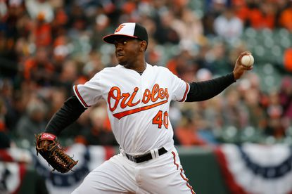 Pitcher Wesley Wright of the Orioles throws to a Toronto Blue Jays batter in the eighth inning during the Orioles home opener at Camden Yards on April 10, 2015 in Baltimore.