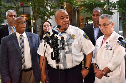 "Mayor Bernard C. ""Jack"" Young, left, and Police Commissioner Michael Harrison, center, ask witnesses to come forward with information about the shooting of Sgt. Isaac Carrington in a robbery attempt near his home on Aug. 8. Three weeks later Harrison is seeking the public's help finding another suspect who shot at an officer."