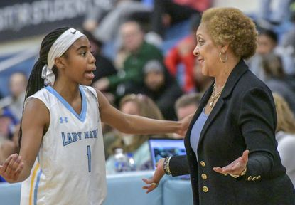 River Hill guard Kennedy Clark, pictured here talking to coach Teresa Waters in a game last season, scored 20 points in the Hawks' 48-26 win over Marriotts Ridge on Friday, Dec. 13, 2019.