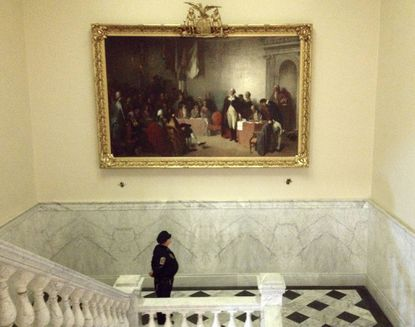"""The painting, """"Washington Resigning His Commission,"""" which first appeared in the State House in 1859, was rehung Friday after a $100,000 restoration."""
