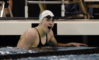 Katie Hoff reacts after winning the 200-meter freestyle in 1:56.08, an American record. She also won the 400 IM yesterday.
