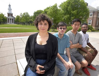 "Erica Taicz, who just graduated from Johns Hopkins, and other students are trying to get the administration to reverse a decision to end ""covered grades"" which are hidden from their transcript. From left are: Taicz; John Hughes, 20, a rising junior; Jonathan Liu, 21, who just graduated, and Kwame Alston, 20, a rising junior."