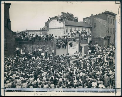 Hundreds of people show up on June 22, 1939, for the funeral of noted jazz drummer Chick Webb, who was born in Baltimore and died at age 34.