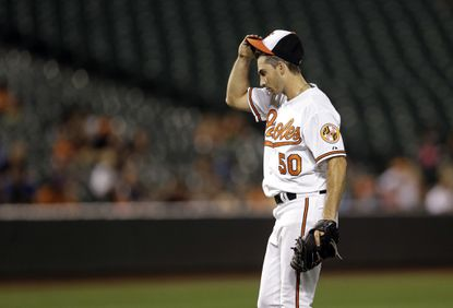Orioles starting pitcher Miguel Gonzalez pauses on the mound against the Minnesota Twins, Thursday, Aug. 20, 2015, in Baltimore.