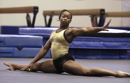 In this Oct. 8, 2015, photo, University of California gymnast Toni-Ann Williams works on her floor routine during practice in Berkeley, Calif. Jamaica's hopes of making history by qualifying the country's first gymnast to an Olympics are riding on Williams' every high-flying flip and acrobatic twist.