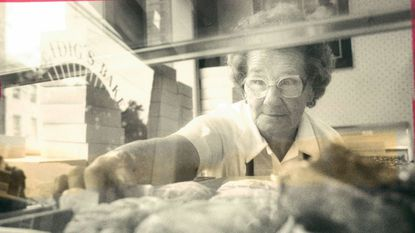 Libby Smith reaches into the pastry case at Leidig's Bakery in 1988.