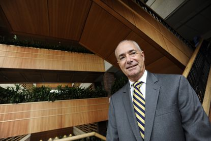 GBMC president Dr. John B. Chessare is pictured on the stairwell in the Yaggy Atrium of the hospital.