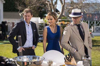 """The Selection Committee Bobby Flay, Giada De Laurentiis and Alton Brown checking in on Finalists cooking for the Star Challenge """"Burger Bash"""" as seen on Food Network Star, Season 9."""