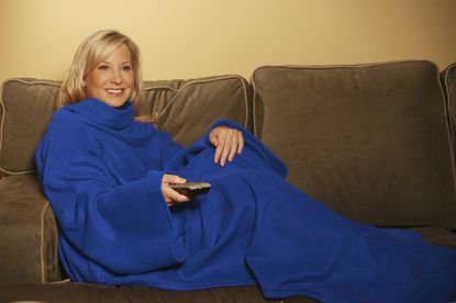 "In this product image provided by Allstar Products Group, a ""Snuggie"" is modeled. Previously only available online or through TV commercials, Snuggies are now being stocked in tens of thousands of retail locations."