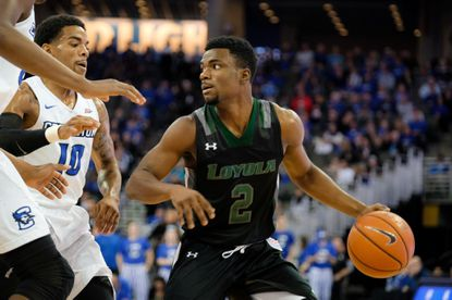 Loyola Maryland's Andre Walker looks for an opening around Creighton's Maurice Watson Jr. during a game at the CenturyLink Center on November 26, 2016 in Omaha, Nebraska.