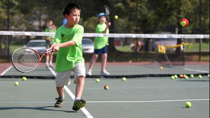 At a tennis camp in 2013, Andrews Zhong, 8, of Ellicott City, at Centennial Park West in Ellicott City.