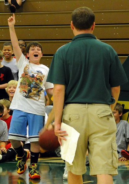 Josh Popielski, of Westminster, reacts during basketball camp at McDaniel College Monday as McDaniel men's basketball coach Kevin Curley looks on.