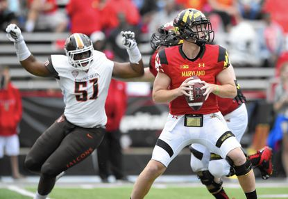 Maryland quarterback Caleb Rowe (7) looks to pass as Bowling Green defensive lineman Malik Brown (51) pursues during the second half of an NCAA college football game, Saturday, Sept. 12, 2015, in College Park, Md. Bowling Green won 48-27. (AP Photo/Nick Wass)