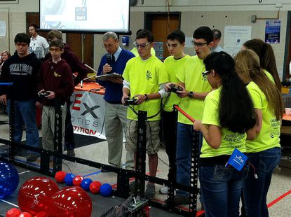 The yellow-shirted members of the Century High School VEX Robotics team compete in a qualifying match for the state championship at the Baltimore Polytechnic Institute on Jan. 11. Pictured from left, are: AJ Johnson, Eric Lotter, David Pape, Mary-Kate Bull, Grayson Miller and Mihika Shah.