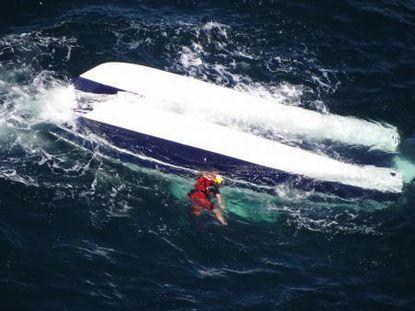 The U.S. Coast Guard released this image of rescue efforts involving a capsized catamaran.