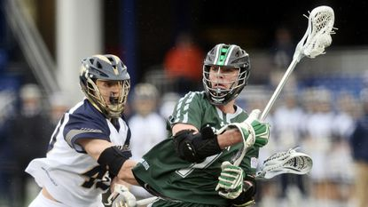 Navy's DJ Plumer, left, defends against Loyola's Pat Spencer in the second quarter. The visiting Greyhounds defeated the Midshipmen, 15-9.