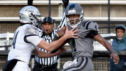 St. Frances quarterback Jalon Jones eludes Gilman's Piper Bond, left, to score a touchdown in the 2017 MIAA A Conference football championship.