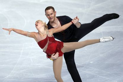 In this Nov. 15, 2013, file photo, Caydee Denney and John Coughlin, of the United States, perform at Bercy arena in Paris.