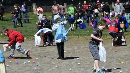 Six-year-olds collect eggs during the Westminster egg hunt at the Westminster City Playground on April 8, 2017.
