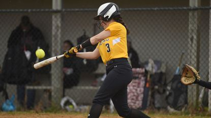 South Carroll's Hailey Wolfrey connects with a pitch during a softball game against Winters Mill at South Carroll High School on Monday, March 25.