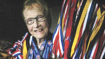 Doris B. Russell, then 90, is pictured in 2010 after winning six medals at the U.S. Masters Short Course National Championships in Atlanta. She's pictured here with some of her collection of more than 200 medals.
