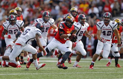 Maryland running back Ty Johnson breaks into the open field in the second half.