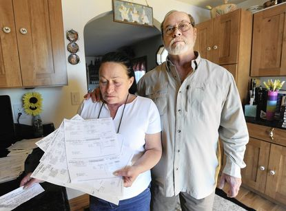 Bill and Cindy Molick's mortgage payment had increased to over $300 since their water and sewage bills dramatically increased in February 2011.