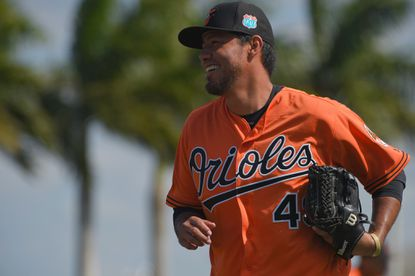 Orioles pitcher Yovani Gallardo smiles at the first day of workouts for position players as well as pitchers and catchers on the field during spring training at the Ed Smith Stadium complex.