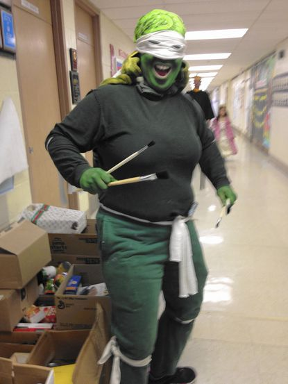 Bond Mill Elementary art teacher Jessica Cowan was a bid hit with her Ninja Turtle costume during the Fall Festival parade Oct. 31.