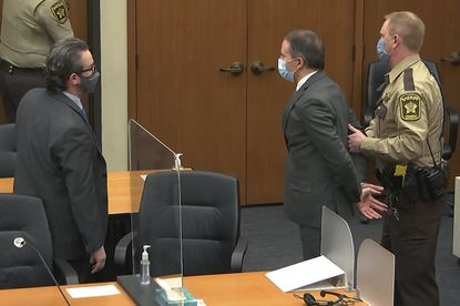 In this image from video, former Minneapolis police officer Derek Chauvin is taken into custody as his attorney Eric Nelson, left, watches, after his bail was revoked after he was found guilty on all three counts in his trial for the 2020 death of George Floyd, Tuesday, April 20, 2021, at the Hennepin County Courthouse in Minneapolis.