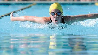 Allison Tomsuden won both the 100-meter freestyle and the 50 butterfly in 15-and-over division of Central Maryland Swim League championships in Winfield recently.