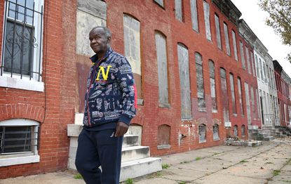 """The notorious drug kingpin Maurice """"Peanut"""" King walks along Holbrook Street in his old neighborhood. He was released from prison in June after being locked up for more than 35 years. October 28, 2019"""