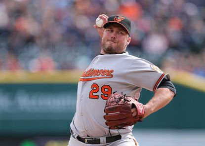 Tommy Hunter pitches for the Orioles against the Detroit Tigers on April 6, 2014. He was traded last year.