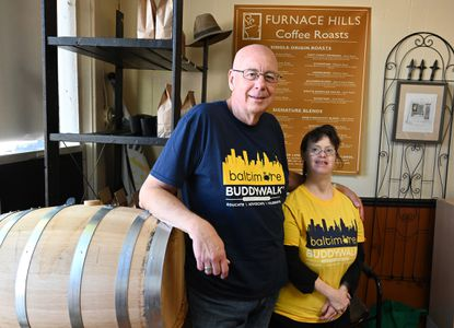 Dave Baldwin, owner of Furnace Hills Coffee, and his daughter Erin at their shop on Main Street in Westminster on Friday, October 11. They created a coffee blend called Buddy Walk, with proceeds benefiting the Buddy Walks locally and across the country.