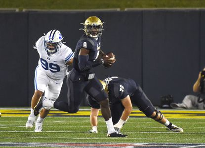 It's unclear whether senior Dalen Morris, seen running with the ball against BYU on Labor Day, will remain the Navy starting quarterback for the American Athletic Conference opener against Tulane.