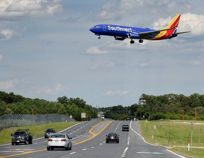 An arriving Southwest Airlines airplane approaches Baltimore/Washington International Thurgood Marshall Airport to land on Tuesday afternoon.