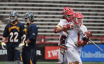 Maryland's Matt Rambo, right, celebrates with Colin Heacock after Rambo's third quarter goal. Maryland defeated the Quinnipiac Bobcats 13-6 in anNCAA men's lacrosse tournamentgame Sunday in College Park.