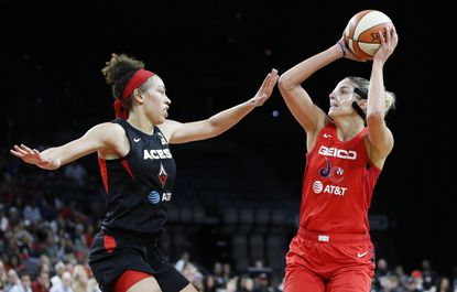 The Mystics' Elena Delle Donne shoots against the Aces' Dearica Hamby during the second half of Game 4 of a WNBA playoff series Tuesday, Sept. 24, 2019, in Las Vegas.