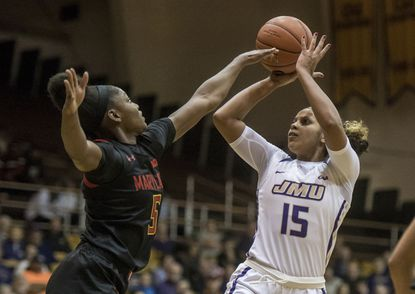 James Madison guard Lexie Barrier (15) shoots as Maryland guard Kaila Charles (5) defends during the first half of an NCAA college basketball game in Harrisonburg, Va., Wednesday, Nov. 13, 2019. (Daniel Lin/Daily News-Record via AP)