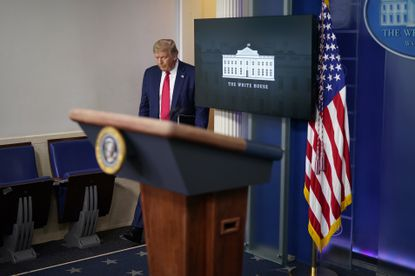 President Donald Trump enters the briefing room at the White House in Washington, Thursday, July 23, 2020, where he announced the Jacksonville, Fla., component of the Republican National Convention has been cancelled.
