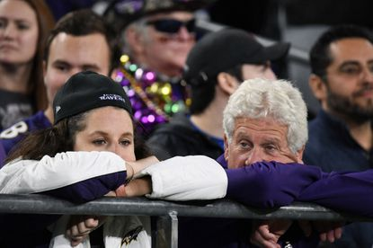 Dejected Ravens fans can hardly watch the game as the Ravens lose to the Titans in the Divisional Playoff at M&T Bank Stadium.