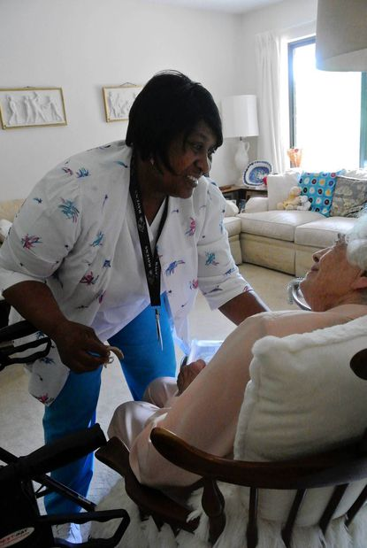 Dawn Lamb assists a resident at Roland Park Place