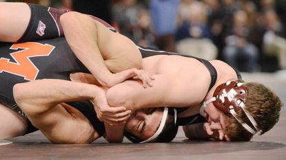 Winters Mill's Hunter Lowe wrestles Middletown's Mert Gulen during their 182-pound bout in the MPSSAA state wrestling tournament in Upper Marlboro Saturday, March 4, 2017.