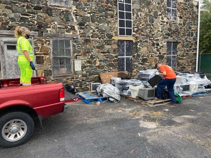City of Laurel workers load monitors into Mike McLaughlin's truck that were collected during the city's E-cycle event earlier this month.