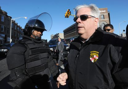 Gov. Larry Hogan, right, visits west Baltimore at Pennsylvania and North Avenues the day after riots broke out there and in other parts of Baltimore, sparked by the death of Freddie Gray on April 19, 2015.