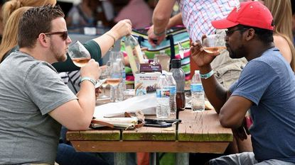 Roby Bradford, left, of Long Neck, Delaware, and Dominick Winder, of Owings Mills, drink wine during the Maryland Wine Festival at the Carroll County Farm Museum in Westminster on Sept. 16, 2017.